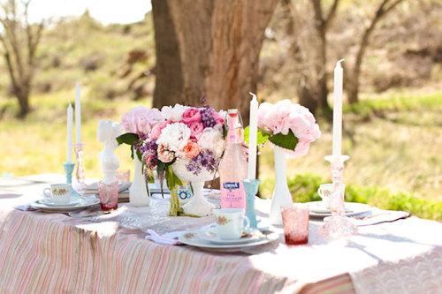 Outdoors table arrangement pretty bridal shower
