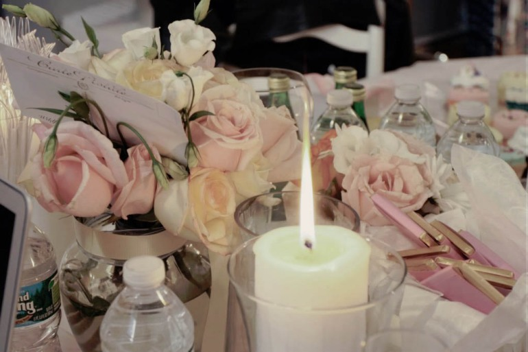 Messy candles and flowers table setting